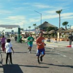 Racers running down the Malecon