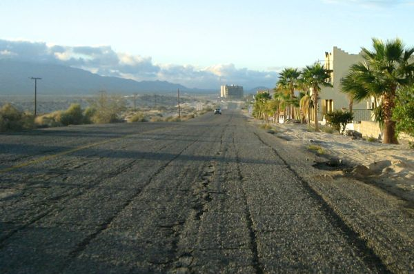 Road from Airport to town. The Baja Diamante condominiums is the building in the center distance